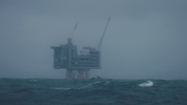industrial oil rig offshore platform construction site on the north seacoast - north sea stock videos & royalty-free footage