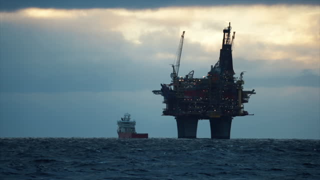 industrial oil rig offshore platform construction site on the north seacoast - petrol stock videos & royalty-free footage