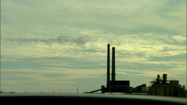 ws industrial plant w/ two tall smoke stacks blue cloudy sky bg industry pollution global warming air quality - paper industry stock videos & royalty-free footage