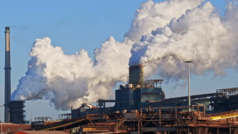 industrial plant with big smoke stacks - climate stock videos & royalty-free footage