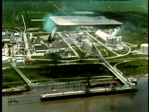 1969 MONTAGE AERIAL WS Industrial plants and refineries lining riverbank from Baton Rouge to the Gulf of Mexico/ Louisiana, USA/ AUDIO