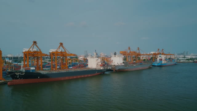 industrial port with containers ship,aerial view - darsena video stock e b–roll