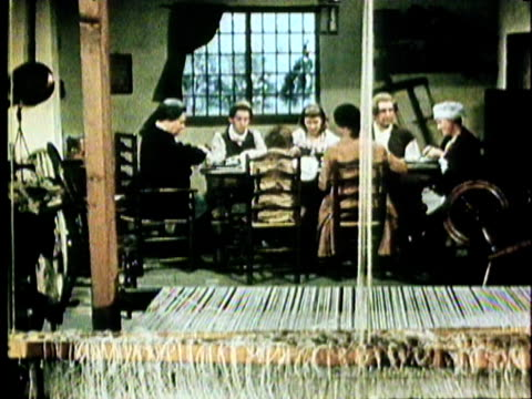 1970 reenactment industrial revolution in england ws td wool textile loom with family having dinner in background - 18th century style stock videos and b-roll footage