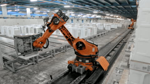 time-lapse industrial robot moving up the production hall and sorting the products - plant stock videos & royalty-free footage