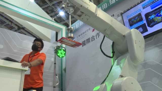 industrial robotic arms are the focus at the taiwan automation intelligence and robot show, which features more than 750 exhibitors - taiwan stock videos & royalty-free footage