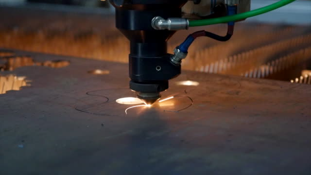 industrial robotic laser cutter which cuts metal