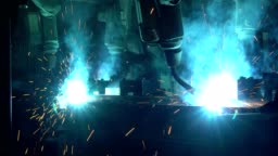 Industrial robots are welding automotive part in factory