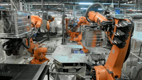 time-lapse industrial robots in operation in a factory - industry stock videos & royalty-free footage