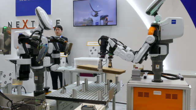 industrial robots nextage of kawada industries perform during the international robot exhibition 2019 in tokyo big sight on december 21 tokyo, japan.... - machinery stock videos & royalty-free footage