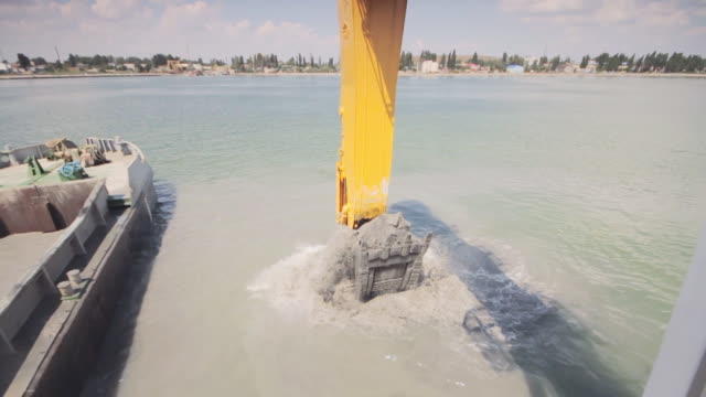 industrial set excavating the seabed - bulldozer stock videos and b-roll footage