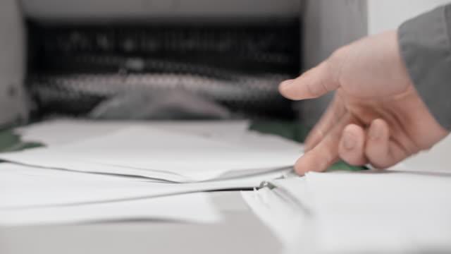 industrial shredder destroying documents - paper stock videos & royalty-free footage