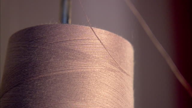 industrial spools of gold thread on holder, thread feeding fast off spool, shaking. fashion district, small business, hand-made, labor intensive,... - industrial designer stock videos & royalty-free footage