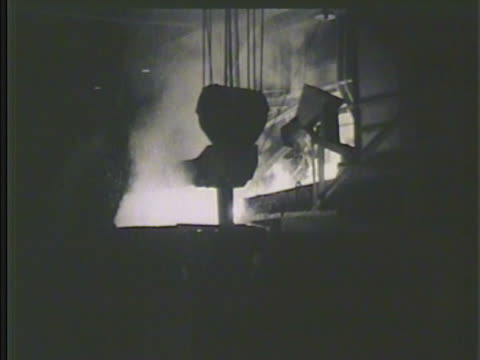 Industrial steel mill w/ silhouette of burning blast furnace smoke pouring molten iron Steelmaking ore metal plant