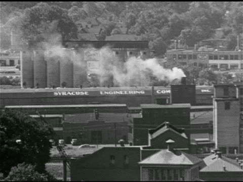 industrial tanks traffic passing ha ws above syracuse engineering company w/ smoking chimney ws manufacturing factory warehouses cityscape ws loew's... - theater industry stock videos and b-roll footage