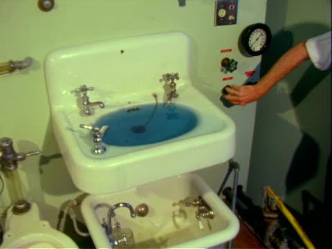 industrial testing of bathroom fixtures - urinal stock videos & royalty-free footage