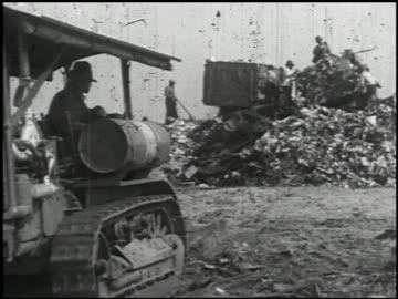 vidéos et rushes de industrial uses of 'caterpillar' tractors - 5 of 14 - caterpillar inc.
