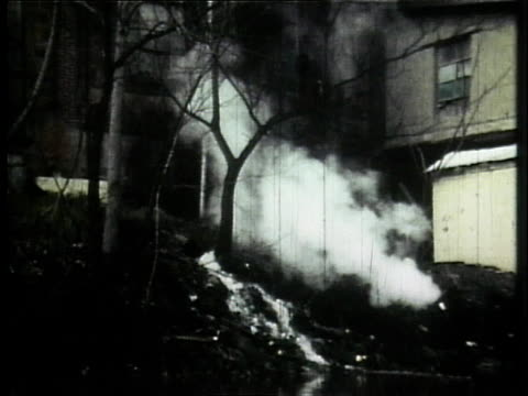 1966 ws industrial waste pouring into the cuyahoga river / ohio, united states - fiume cuyahoga video stock e b–roll