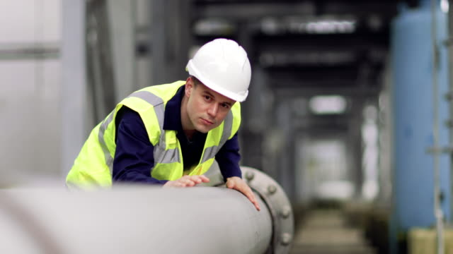 industrial worker checking pipeline - pipe stock videos & royalty-free footage