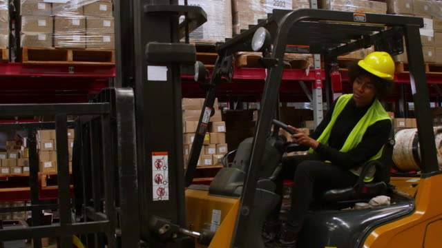 industrial worker operating forklift in warehouse - forklift truck stock videos and b-roll footage