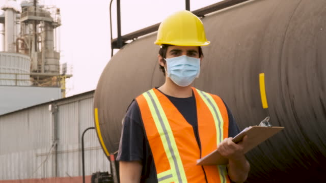 industrial worker posing in front of a liquified petroleum train car container - manufacturing occupation stock videos & royalty-free footage