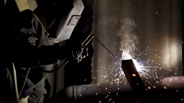 industrial worker welding metal pipe - welding stock videos & royalty-free footage