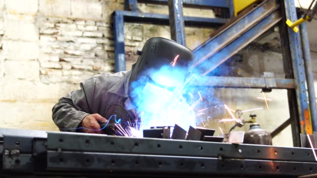 industrial worker welding steel - grinder industrial equipment stock videos & royalty-free footage
