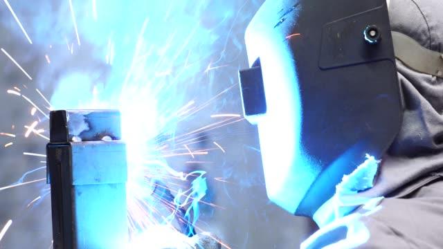 industrial worker welding steel - weapon stock videos & royalty-free footage