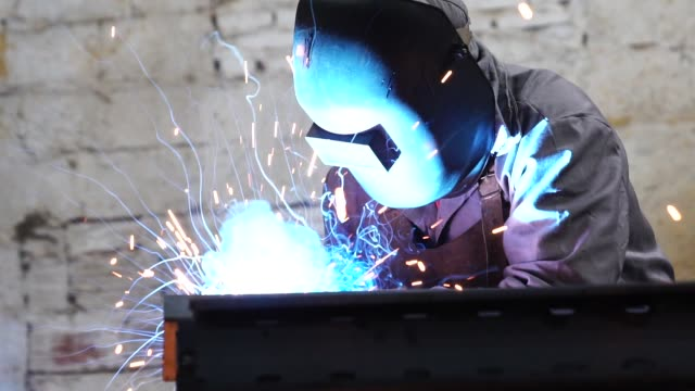 industrial worker welding steel - foundry stock videos & royalty-free footage