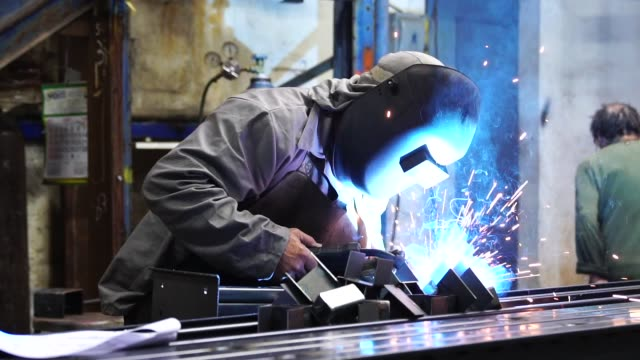 industrial worker welding steel - construction equipment stock videos & royalty-free footage