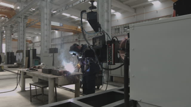 industrial worker welding - car plant stock videos & royalty-free footage