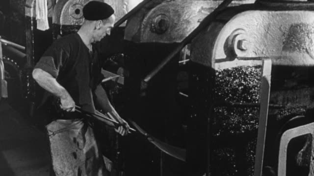 montage industrial workers forming flat sheet iron in factory / treforest, wales, united kingdom - 1950 stock videos & royalty-free footage