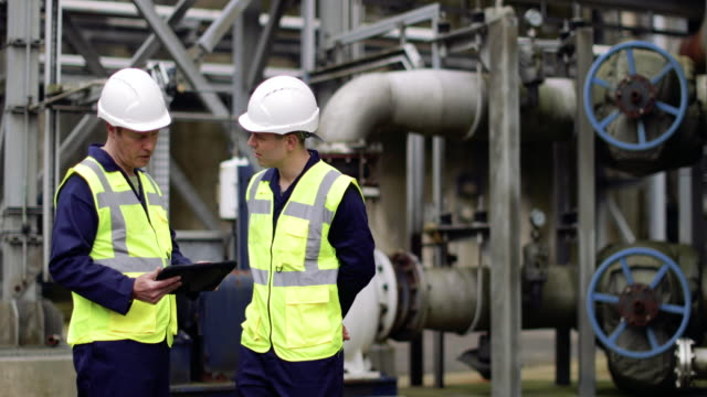 industrial workers using a digital tablet on site - refinery stock videos & royalty-free footage