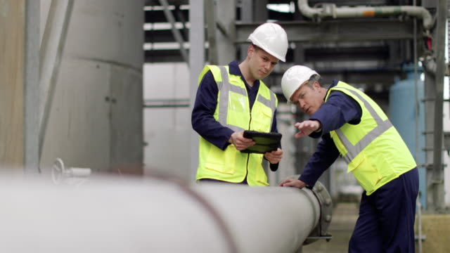 Industrial workers using a digital tablet on site