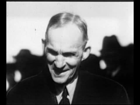 cu industrialist henry ford smiles / montage employees work on car on assembly line / montage ford wife clara jane bryant ford son edsel and group of... - ford stock-videos und b-roll-filmmaterial