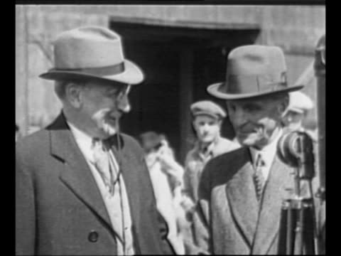 industrialist henry ford smiles shakes hands with offcamera person / montage ford and group of men at ford exhibit and with oil tycoon rufus cutler... - motor oil stock videos and b-roll footage