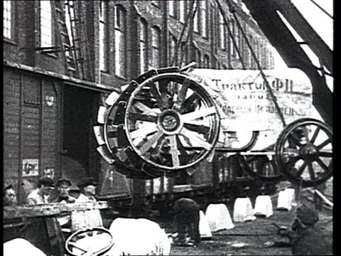 "industrialization, 1931. tractors of the ""red putilov"" factory are loaded on goods wagons, freight cars and trains, train wheels, railway tracks. a... - 1931 stock videos & royalty-free footage"