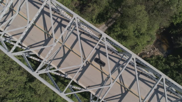 industrial-looking steel bridge near baltimore, maryland. looking-down bird-eye view drone video with the panning camera motion. - baltimore maryland stock videos & royalty-free footage