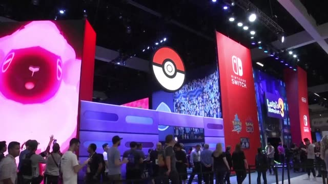 industry insiders and game lovers throng to the premier electronic entertainment expo in los angeles for peeks at hot titles set for release in the... - releasing stock videos & royalty-free footage