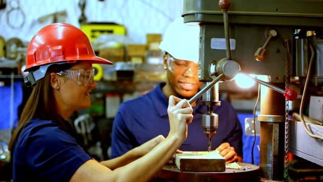 industry: male and female workers at drill press - health and safety stock videos & royalty-free footage
