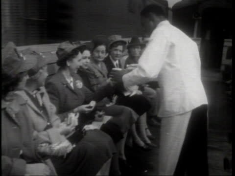 / industry on parade / reel 72 / segment a lesson for teachers / a railway porter serving the teachers lunch on an open air dining car / the large... - narrating stock videos and b-roll footage