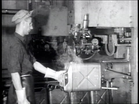 industry on parade television show theme introduction / a worker uses a machine to shape a gas can / a worker spot welds the gas can / tops of the... - damages television show stock videos and b-roll footage