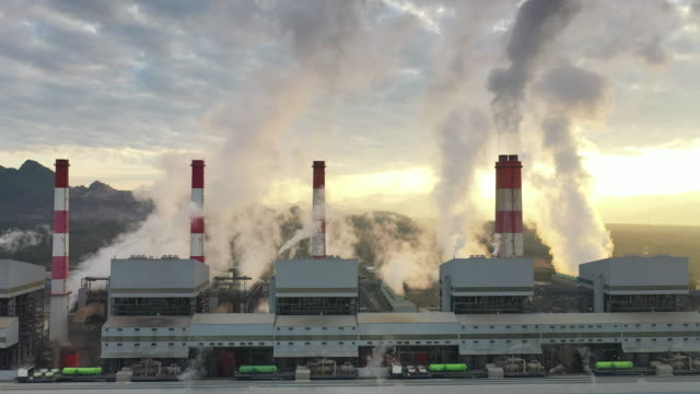 industry power plant pipes pollute the atmosphere with smoke - power station stock videos & royalty-free footage