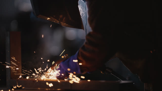 slo mo cu industry professional welds metal with torch - metal industry stock videos & royalty-free footage