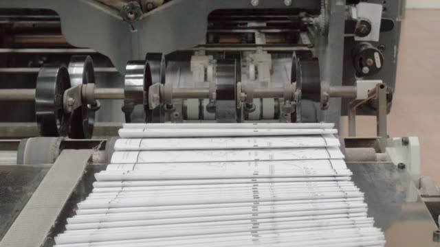 industry robots in production line of paper. operating production line machine in work. - machine part stock videos & royalty-free footage