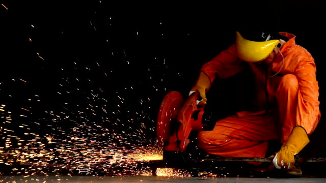 industry worker cutting steel pipe by metal grinder with lighting sparks - grinder industrial equipment stock videos & royalty-free footage