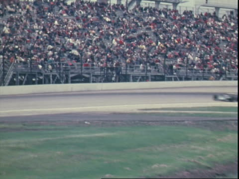 indy race cars racing past crowded spectators stands at indianapolis motor speedway / joe leonard driving samsonite sponsored parnelli offenhauser /... - mike rutherford stock videos & royalty-free footage