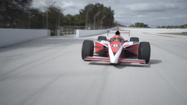 ms pov ts indy type racing car racing on track / orlando, florida, united states - racing car stock videos & royalty-free footage