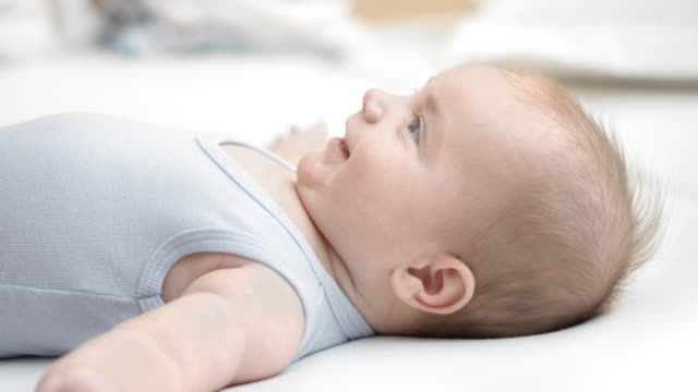 infant boy lying on his back listening to someone talking - one baby boy only stock videos & royalty-free footage