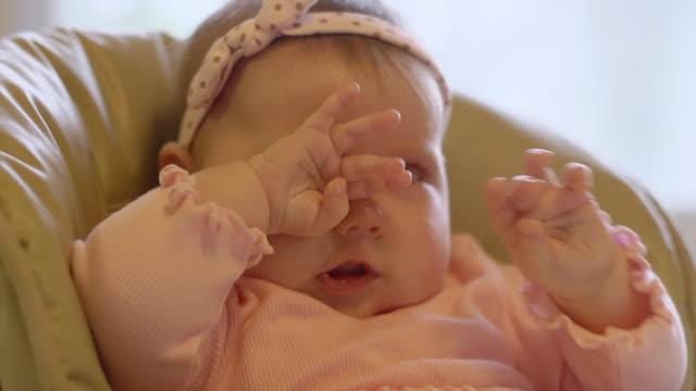 CU Infant rubbing eyes / Ann Arbor, Michigan, United States