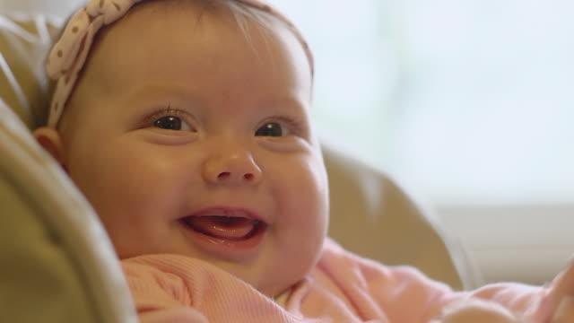 vídeos y material grabado en eventos de stock de cu infant sits in chair and smiling / ann arbor, michigan, united states - ann arbor